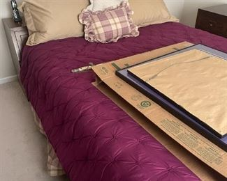. . . a full-sized bed and mattress set