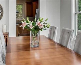 Available for presale - text for price and more info Cherry dining table and 8 chairs (linen chair covers not included)