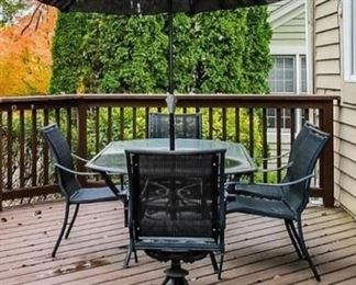 cast aluminum rectangle patio table and 5 chairs