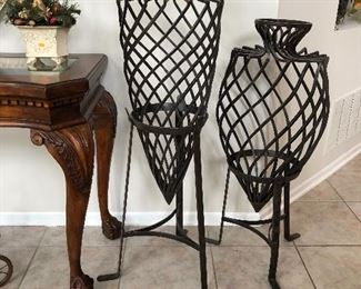 Heavy wrought iron urn on stand for indoor decor or outdoor garden accent