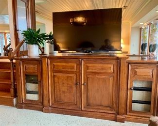 """Cabinet that hides/raises a TV by Hooker, the TV pictured is a 55"""" Samsung)"""