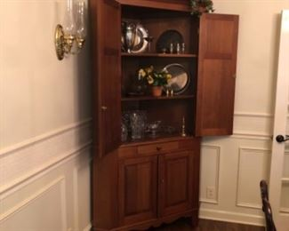 Open view of a Beautiful KY cherry corner cabinet, made by Colonial House Furniture, Auburn KY.  This piece is in excellent condition and ready for decorating.