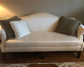 Modern white camel back sofa.  This is not your grandmothers sofa.