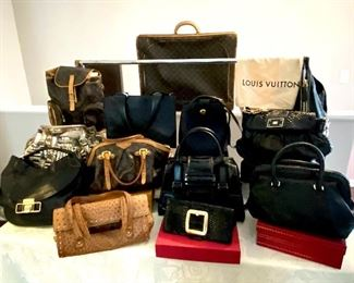 An extraordinary Collection of Ladies Handbags including . . . .