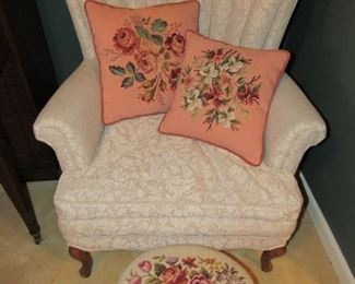 Down filled chair with embroidered pieces