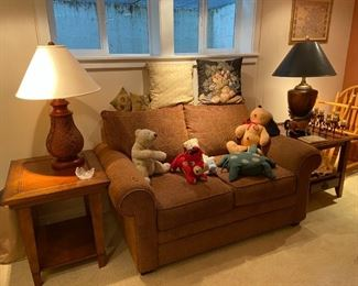 downstairs.  Basset loveseat. Retail was $839.00. Priced at  $175. Excellent. End tables are also Basset.{ And lamps.}