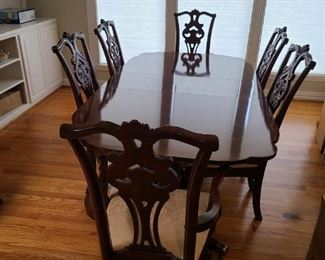 American Drew brand dining table with 6 chairs. It has two leaves
