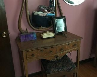 Love this little oak vanity with swing mirror.  Great vintage mirror in background.