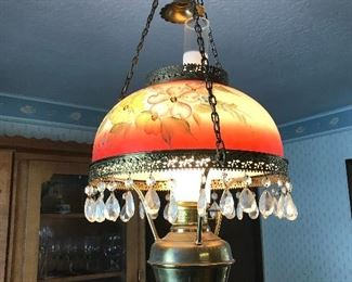 This is a beautiful hand painted lamp with glass prisms.  Electrician has to remove lamps.