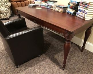 Bombay desk, VHS tapes and rolling desk chair