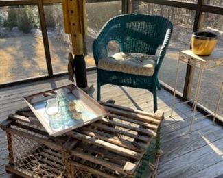 VINTAGE LOBSTER TRAP FROM MAINE, VINTAGE WICKER CHAIR AND TALL WOODEN FISHERMAN.
