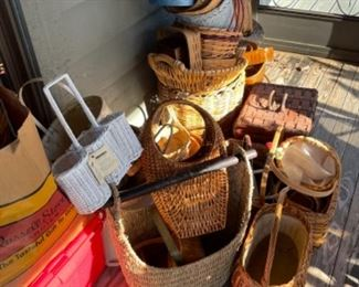 ASSORTMENT OF BASKETS ON THE SCREENED PORCH