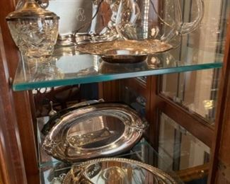 LOTS OF SILVER PLATE IN DINING ROOM CHINA CABINET