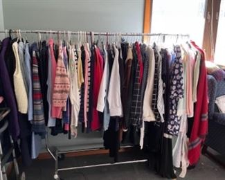RACK OF DRESSES, SKIRTS AND JACKETS