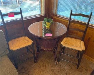 Rattan round table and 2 rush seat chairs