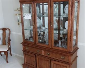 """oak  colored  dining  room  set china cabinet-- china  cabinet  is 59"""" wide and  83""""  high   The  set  is 895.00   Condition  is  very  good."""