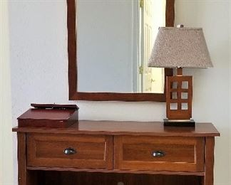 Console storage great for entryway, livingroom, bedroom, Craftsman style wooden lamp. Wooden rectangle mirror.