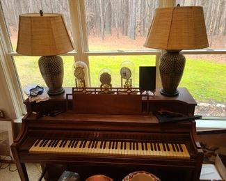 Piano, 3 glass covered clocks, lamps