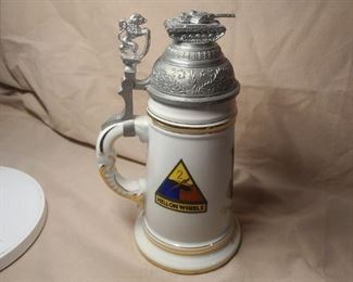 WW2 Allied( USA) German made stein for Lt. Col. Egger, the 48th Armed, Med. BN. with Lithopane on bottom interior( nude woman)* tank on top of lid(rare) Hell on Wheels emblem*gold plating is impeccable condition* lid has very light wear along rim in front. 770-846-3227 to by now