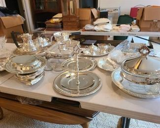 multiples of silver plate servers for banquets, parties, get together's; look nice;