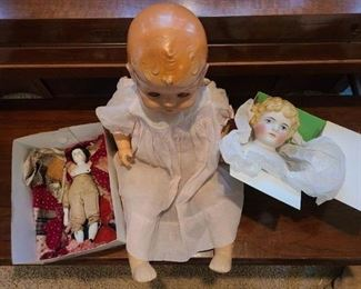 Middle is 1940's composition doll, clothing in okay condition, this is a group photo of all  together