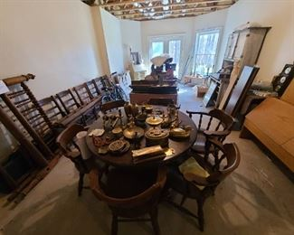 6 chair dinner table round, to left 1800's rope bed, behind are tools,
