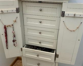 Inside of white jewelry armoire