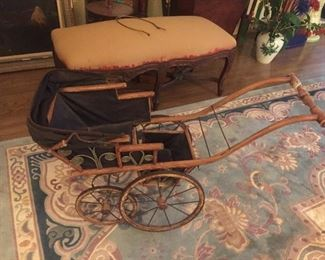 antique child's doll carriage with carriage hood and in working order
