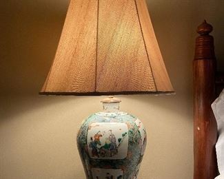 Antique Chinese lidded urn made into a lamp.  Urn is not at compromised by the lamp - it sits on a rosewood base, electrical works not in the urn.  $1200