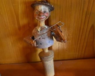 DSC 1517 Vintage ANRI style Mechanical Wooden  Bottle Stopper each Stopper operates similar to a nutcracker, this one plays the violin. These are very difficult to find