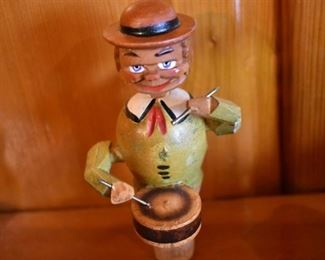 DSC 1515 Vintage ANRI style Mechanical Wooden  Bottle Stopper each Stopper operates similar to a nutcracker, this one plays the drums. These are very difficult to find