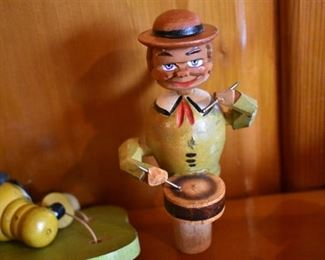 DSC 1514 Vintage ANRI style Mechanical Wooden  Bottle Stopper each Stopper operates similar to a nutcracker, this one plays the drums. These are very difficult to find