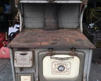 Antique wood burning stove, NOT actual stove, stove is stored and picture is impossible to take at time of press,