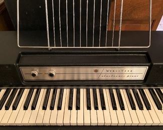 AWESOME WURLITZER MODEL 200A OLD SCHOOL ELECTRIC PIANO WITH SUSTAIN PEDAL & ORIGINAL ROLLING HARDCASE, ALL COMPLETE IN SWEET WORKING CONDITION. DONT MISS OUT ON THIS RARE FIND.