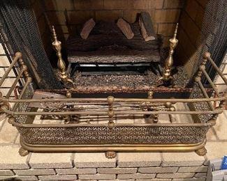 Brass fireplace fender, andirons, tools