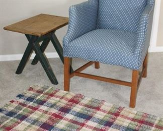 """Chippendale Style Willamsburg Blue Custom Upholstery Wing Back Chair.   Shown with a Primitive Side Table with Natural Wood Cutting Board Top and Blue Paint """"X"""" Legs (21 3/4""""W x 16""""D x 20""""H)and a Plaid Rag Rug"""