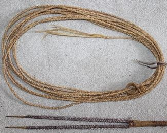Vintage 40' Rawhide Lariat.  Also shown is a Carved Wooden Handmade/Decorated what appears to be some sort of Tribal Weapon.