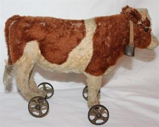 """Steiff  Made in Germany Antique Mohair Cow with Leather Collar and Bell Pull Toy on Wheels Circa 1590-1910. (13'W x 5""""D x 10""""H)"""