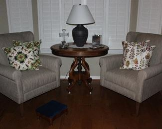 """Bassett Beige Linen Upholstered Georgia Traditional Wingback Chairs and Pier One Embroidery Throw Pillows. Also shown:  Victorian Antique Oval Center Table on Original Porcelain Casters (25""""W x 26""""D x 29""""H)"""