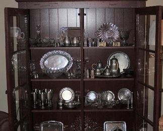 """Pewter:  Royal Holland, Stieff, Old Colony. Italy, Hedko, Web, Williamsburg, Norway Selandia and  Hagness and Fostoria Colony Crystal  - Contents  of Deep Red Stained Glass Pane Double Door Cabinet on Bun Feet.  (50""""W x 17""""D x 69.5""""H):"""