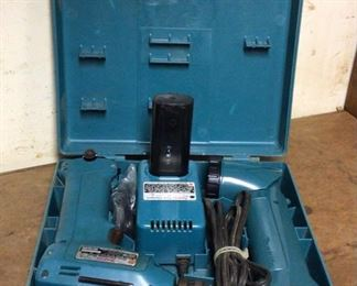 Mikita 10mm cordless drill with flashlight and battery charger. Model 6010d