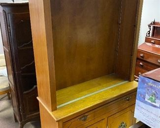 tall hutch/bookcase that has sliding glass doors (not pictured) and 3 shelves (NOT PICTURED).