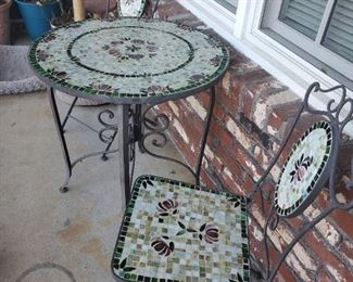 Mosaic tile and iron bistro set.