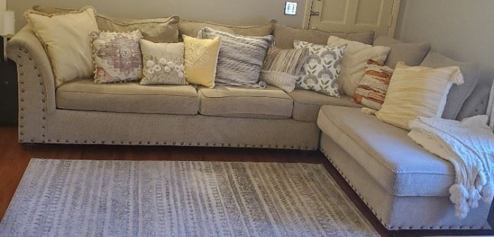 Nice Chenille Upholstered Sectional Sofa with Metal Studs, Outer Accent Pillows sold separately. Area rug and comfy throws sold separately.