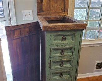 Beautiful Farmhouse Standing Jewelry Chest with Side Panels which Open to Hang Necklaces Inside, Plus Lift Up Mirror Top with Storage Compartment, Full Front of Storage Drawers. Lovely Distressed Aqua Color.