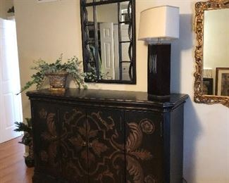 painted black sideboard, arched mirror and table lamp