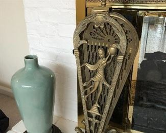 floor vase and brass fireplace fan screen