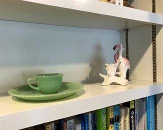a couple pieces of jadeite and flamingo figurine