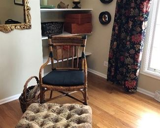 pretty home decor includes a rattan chair and tufted foot stool