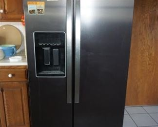Side by side Whirlpool Refrigerator